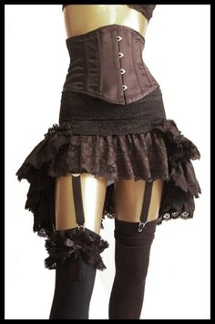 Gorgeous lace ruffle skirt with corset. Would make a great detail for a steampunk costume!