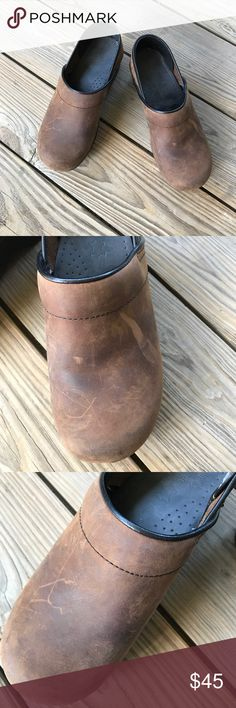 Dansko Leather Clogs Dansko brown leather Clogs. A few scuffs- shown in photos. They have many years of life left in them. Thanks for shopping my closet Dansko Shoes Mules & Clogs