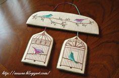 uniquely shaped cross stitch bird cage ornament