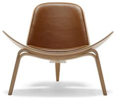 Originally designed by Hans Wegner in 1963, this chair achieves an almost absence of density due to its wing-like seat and the curved archness of its tapered legs.