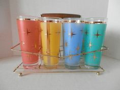 COLORFUL MID CENTURY GLASS SET WITH METAL CARRIER