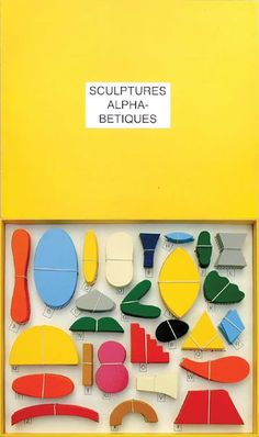"From French artist Paul Cox, ""Sculptures Alphabetique,"" coloured wooden blocks in a box, part game, part art piece."