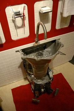Repurposed car parts bathroom fixtures. Oh, wouldn't this be a perfect man cave accessory?