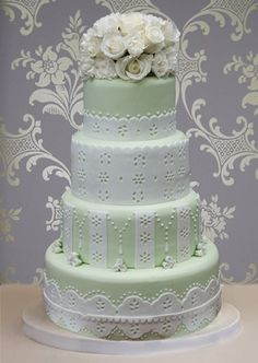 I absolutely love this cake! I'm doing eyelet lace themed and it goes perfectly! Maybe light blue instead of green though?