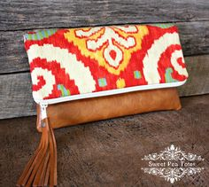 Ikat Upholstery Foldover Clutch / Leather Tassel by SweetPeaTotes, $38.00