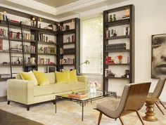 by Chloe Warner    Living room with built in wraparound library shelves