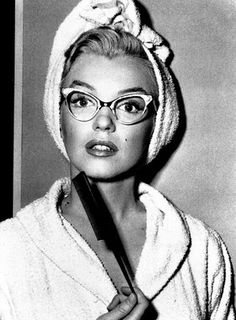 marilyn in glasses - notice how they fit with the arch of her eyebrows