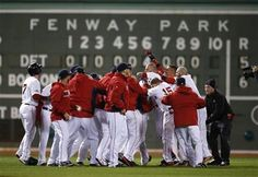 Boston Red Sox players celebrate after Game 2 of the American League baseball championship series against the Detroit Tigers Sunday, Oct. 13, 2013. The Red Sox won 6-5. (AP Photo/ Elise Amendola)