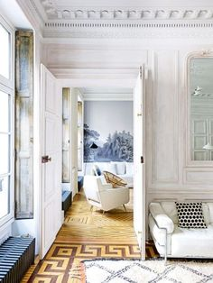 """House tour: a New York family's Parisian holiday home: When it comes to interiors, the owner of this Parisian apartment — an American magazine publisher — favours a number of things. She is a fan of stripes — """"If I see them, I'm dead. I'll get them every time"""" — and of a black-and-white palette — """"It's a combination that's endlessly chic and timeless."""" She also has a weakness for Moroccan rugs, believing they immediately make a room more inviting, and advises that you should also never ..."""