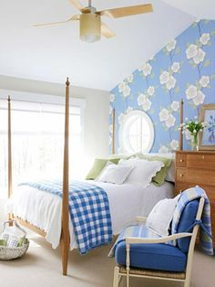 Garden Delight - Create a light and cheerful mood in a bedroom with whites, blues and greens. An oversize, stylized floral wallpaper on just one wall gives the room a touch of garden-inspired whimsy. (Wallpaper on all four walls would be overkill.) Sage-green pillows add contrast to the white matelasse coverlet and shams and blue-and-white checked quilt.