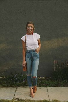 Summer: The simplest, laid back summer chic outfit: Ripped Mom jeans + roll sleeve white t + tan bag and sandals.