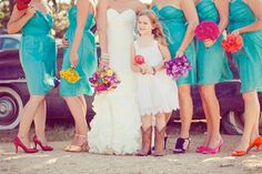Matching dresses, different color heels with matching flowers