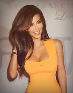 i'm not the biggest kim k. fan & i know this is totally photoshopped, but regardless this is a gorgeous picture. love her hair & makeup! she almost looks like a barbie doll.