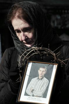 Kyiv, Ukraine. Women carry pictures of dead demonstrators. 26th Feb.