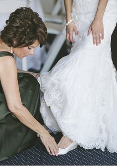 Must have wedding picture! Mom helping put on the brides wedding shoes! What a nice intimate moment to remember always. Photo by http://aliciakingphotography.com Shoes by http://ninashoes.com/rivka_3341?utm_source=Pinterest&utm_medium=Social%20Media%20Campaign&utm_term=Wedding%20Inspiration&utm_content=Mom%20putting%20on%20brides%20shoes%20Shot%20Alicia%20King%20KC%20&utm_campaign=Wedding