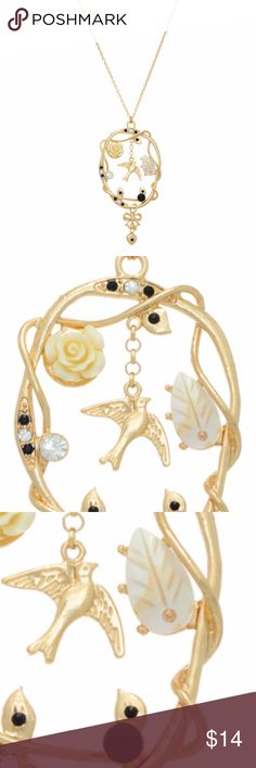 "Gold Romantic Boho Featuring Bird, Rose, and Charm Gold tone necklace displaying a round pendant with black stones, a cream rose, bird, ribbon, and heart charms. Approximately 20"" in length. Florida Farmers Market Jewelry Necklaces"
