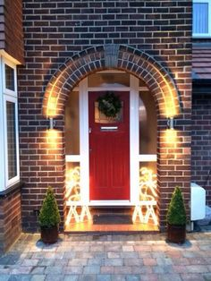 Red Front Door with sidelight panel windows and transom. Beautiful arched brick entry and front porch. Arched Front Door, Front Door Porch, Porch Doors, Front Door Entrance, Exterior Front Doors, House Front Door, Front Door Colors, Glass Front Door, Exterior House Colors
