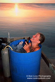 A homemade scuba jacuzzi, beverage and sunset in Roatan, Honduras. Sometimes it doesn't take much money to enjoy the best things in life...