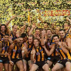 Hawks players celebrate with the Premeirship Cup during the 2014 AFL Grand Final match between the Sydney Swans and the Hawthorn Hawks at Melbourne Cricket Ground on September 2014 in Melbourne, Australia. Australian Football, Pro Cycling, World Of Sports, Premier League, Finals, Celebrities, Aussies, Parental Advisory, Melbourne Australia
