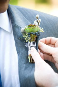 I have no idea what this boutonniere is made out of, but I think it is just awesome!
