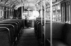 The inside of old buses.The doors of the bus folded back, exposing steep steps up into the car. Riders often had much to say about the price of groceries, their neighbourhood gossip, and sometimes the city issues they had heard discussed on the radio or in the newspaper.