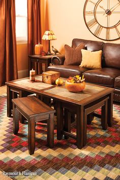 """This Portman coffee table with stools set will help you make a rustic yet refined statement in your living room. With 4 rectangular slate inserts on the tabletop and 4 """"bonus"""" stools for extra seating, this set beautifully combines style and function. Brown Couch Living Room, Home Living Room, Living Room Decor, Dining Room, Dining Table, Brown Leather Furniture, Leather Living Room Furniture, Leather Sofa, Coffee Table With Stools"""