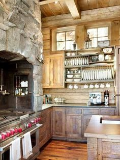 My favorite kitchen cabinets.  Hmmm... where would be a good place for Shayne to put some rock? It really adds a nice element.