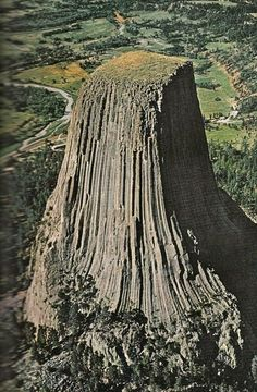 Devil's Tower, Wyoming - this is the center of an ancient volcano where the surrounding 'mountain' has worn away and left the hardened lava. The first national monument in 1906 as proclaimed by Theodore Roosevelt