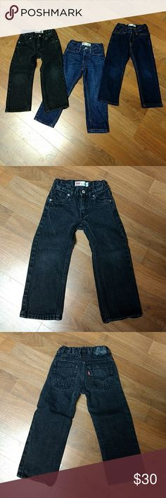Levi's toddler boy jeans 3 pairs of toddler boys Levi's jeans in good condition they are slim, skinny and straight legs  they also have adjustable waist bands,  my grandson is just out growing everything so most of the clothes I have listed are in really good condition. If you have any questions just ask ☺️  ⭐Price is firm and are all sold together ⭐ Levi's Bottoms Jeans