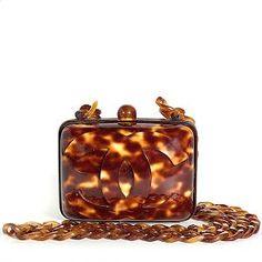 Google Image Result for http://static3.avelleassets.com/productimages/Handbag/Chanel/Chanel-Tortoise-Shell-Handbag_19775_front_large_0.jpg