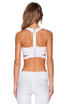 http://www.revolveclothing.es/koral-activewear-transcend-sports-bra-in-white/dp/KORL-WM52/