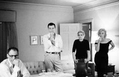""".USA. California. 1960. Arthur MILLER, Yves MONTAND, Simone SIGNORET and Marilyn MONROE in Montand's Beverly Hills Hotel apartment. Montand and Monroe were going to work together for the first time in the new movie, """"Let's Make Love."""" - Photo Bruce Davidson"""