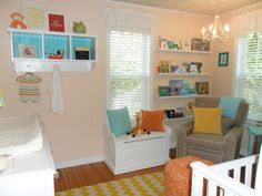 Baby K's Bright Nursery-I love the shelves on the wall and the storage unit under the window. This will fit perfectly in my small nursery, and will add some much needed storage. The storage unit and wall-mounted book holders on the third picture down are also very nice.