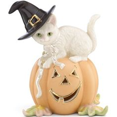 Halloween Mischief Kitty Figurine By Lenox  portrays a cat wearing a black hat while sitting atop a pumpkin. Crafted of glazed ivory china, hand painted, and accented with gold, the cat also has a pearlized ribbon around its neck. A wonderful gift for cat lovers everywhere.