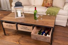 Vino Vintage Coffee Table is made from hand-worked steel and vintage wine crates for storage. The table contains 3 manual slide-out wine crates large enough to hold at least 10 wine bottles each. Our solid wood table top is constructed from reclaimed distressed wood with a weathered patina. Napa Valley meets industrial style in a timeless classic design.