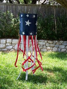 EZ 4th of July windsock with stars cut out with my Cricut and tin cans, spray paint and ribbon