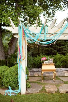 Any excuse to decorate the garden is fine by me. Crepe streamers are an affordable decorative curtain on this arbor + they pick up any hint of a breeze.