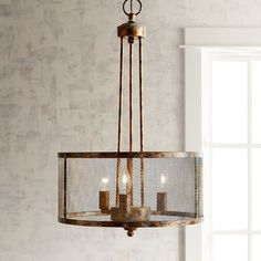 Dare to go distressed with our pendant light that features an iron construction that's worn to perfection. It lights up your dining room, hall or entryway with an industrial modern design that's effortlessly cool.