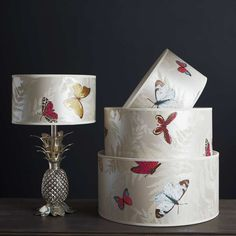 White Farfalla Drum Lamp Shade--this would look cute on those weird little pineapple lamps... Wonder if I could make my own with some fabric/scrapbook paper/wallpaper...