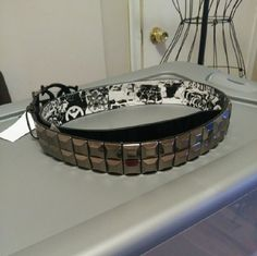 Guess belt brand new with tag Brand new with tag. Never worn. Black with silver stud squares all the way around Black and white designs on inside Large buckle in front with silver G's and says Guess Size Medium Guess Accessories Belts