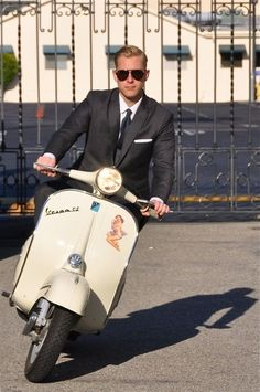 Made famous in  the 60's with The Mod look. Vespa or scooter is a way of life for guys in many cities. Seems like you can wear anything with Vespa especially business suits. Here are some pics of fashionable men on their scooters.