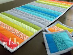 "Don't know why this makes me so happy.  Maybe because it's from a post titled, ""Rainbow Brite.""  Love the idea to make a table runner from packs of coordinated quarter flats."