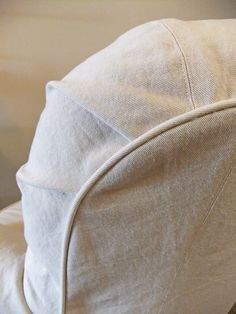 Natural denim slipcover custom made with lots of shaping details.