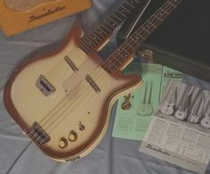 """And dig this: to complete the set, the guitar comes with a rare late '50s Danelectro amp with cool """"clover-leaf"""" front. The amp is in excellent condition. Not sure which amp model this is, but I know they didn't make many in this light tan finish. 