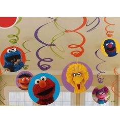 One 12 count package of Sesame Street Birthday Dangling Cutouts. The cutouts measure from 5 inches to 7 inches and have some of your favorite Sesame Street characters faces printed on them. Our Sesame Street Birthday Dangling Cutouts are colorful andSesame