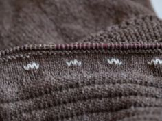 This button-band/button hole tutorial is amazing!   No more disheveled button holes on this girls Knits!