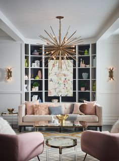 A seamless blend of vintage sophistication and contemporary clout, Tryst offers a striking mix of design elements. Hammered stems radiating from a spherical body shimmer as the light dances across the facets, creating a robust yet airy effect.  Also featuring Vida wall sconces.   #livingroominspo #gatheringspaces #hinkleystyle #vintagedesigninspo #lightingdesign Hinkley Lighting, Wall Sconce Lighting, Chandelier Lighting, Wall Sconces, Chandeliers, Living Room Lighting, Living Room Decor, Living Room Designs, Living Spaces