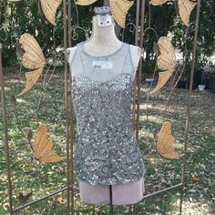 Green Sequin Sheer Top Beautiful army green colored top with sequin on front. Topshop Tops