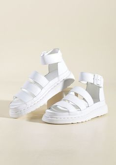 <p>A strut down the sidewalk in these Dr. Martens sandals feels exactly like taking to the stage! This pair's collection of classic leather straps and sleek hardware raises the curtain on your overall look, while their chunky flatforms and bright white hue earn themselves a hearty encore.</p>