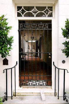 This may be a 'Pretty doorway in Charleston SC', but I think the railings and greenery would work beautifully at our front entrance too. Door Entryway, Entrance Doors, Iron Gates, Iron Doors, Transom Windows, Windows And Doors, Porte Cochere, Front Entrances, Exterior Doors